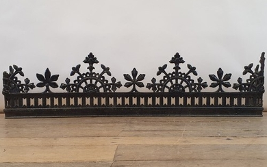 An early 20th century Aesthetic period style cast metal fend...