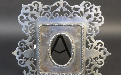 Frame in cut-out and openworked iron. End of the XIXth century. Dim. 24,5*23,5 cm