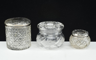 Trio of lidded crystal condiment jars including William