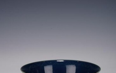 A CHINESE BLUE GLAZE INCISED DRAGON BOWL