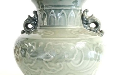 A Chinese celadon Longquan style baluster vase, Qing Dynasty...