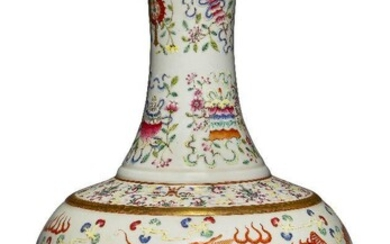 A Chinese porcelain famille rose 'dragon and phoenix' vase, Republic period, decorated to the body with a dragon and a large phoenix among polychrome clouds above lappets around the foot, the neck decorated with the Eight Buddhist Emblems...