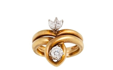 A DIAMOND CROSS OVER RING, set a brilliant cut diamond and t...