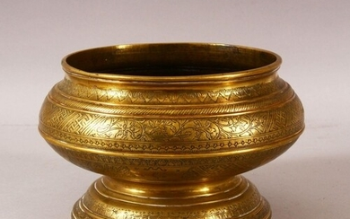 A GOOD ISLAMIC ENGRAVED AND CHASED PEDESTAL BRASS BOWL, prof...