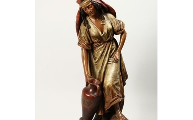 A GOOD LARGE TERRACOTTA FIGURE OF A YOUNG ARAB GIRL carrying...