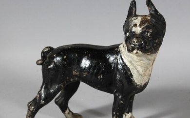 A PAINTED CAST IRON DOG DOORSTOP. 9ins long.