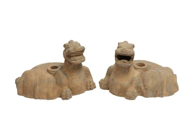 A PAIR OF CHINESE POTTERY 'MYTHICAL BEASTS' CANDLESTICKS.