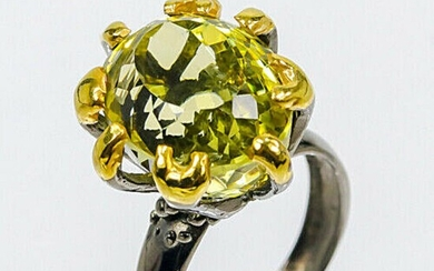 A citrine ring set with an oval-cut citrine, mounted in black rhodium, and gold plated sterling silver. Size 57. – Bruun Rasmussen Auctioneers of Fine Art