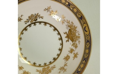 A collection of Minton Dynasty gilded dinnerware: Comprising...