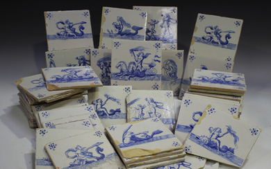 A group of approximately eighty Dutch Delft blue and white tiles, late 19th/early 20th century, each