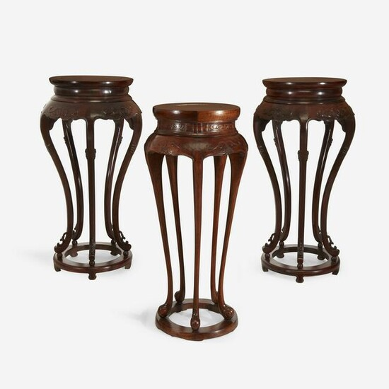 A pair of Chinese hardwood circular stands
