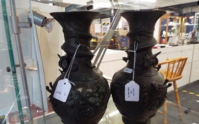 A pair of bronzed vases with applied five toed dragon chasin...