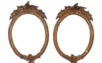 A pair of gilt-composition mirrors, late 20th century, with foliate frames, 35cm high; together with a gilt composition circular mirror and a gilt plaster putto wall bracket (4)