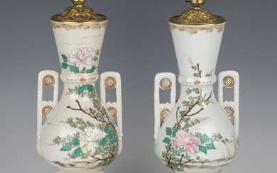 A pair of late 19th century Japanese export porcelain and ormolu mounted table lamps, the twin-handl