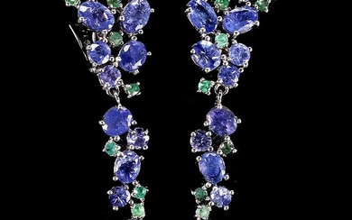 A pair of tanzanite and emerald ear pendants each set with numerous ovel and circular-cut...