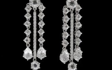 NOT SOLD. A pair of topaz and diamond ear pendants each set with numerous topazes...
