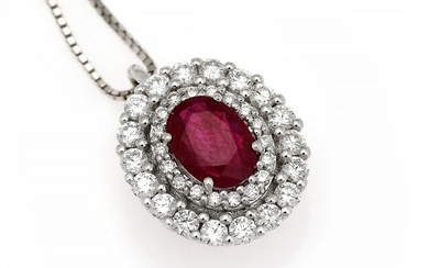 NOT SOLD. A ruby and diamond pendant set with a ruby encircled by numerous diamonds,...