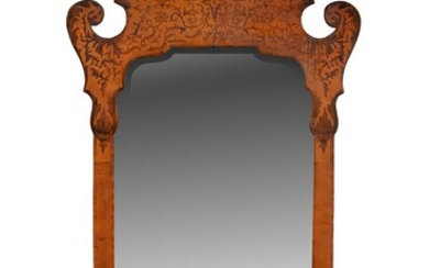 A walnut and inlaid fretwork wall mirror in 18th century style