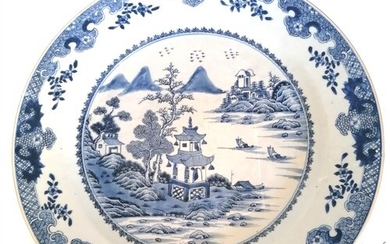Chinese 18th C blue and white charger depicting a harbour sc...