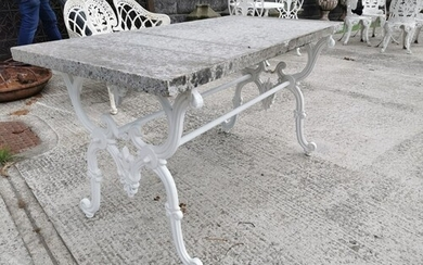 Garden table with cast iron base and marble top in the Itali...