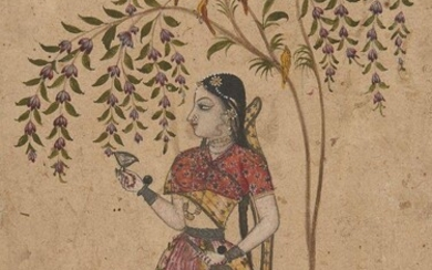 Girl holding a Wine Cup and Bottle standing under a Tree, North Deccan, possibly Maratha, India, early 18th century, opaque pigments heightened with silver and gold on paper, 18.5 x 12.5cm. A young girl standing under a flowering tree is one of the...