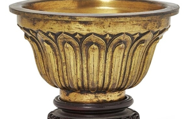 Property of a Gentleman (lots 36-85) A Sino-Tibetan gilt-bronze 'lotus' bowl, Qianlong mark and probably of the period, of ogee form with flat everted rim, finely cast to the sides with vertical lotus petals, incised with four-character Qianlong...