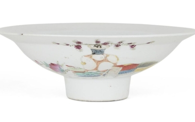 A Chinese porcelain famille rose footed bowl, Republic period, painted with a large vase bearing flowering branches amongst scholars objects and peaches, 20.2cm diameter