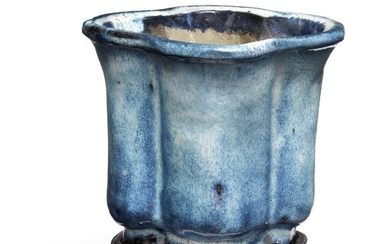 NOT SOLD. A Chinese pottery flowerpot of quatrefoil form. Guandong ware. Qing, 19th century. H....