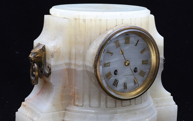 A FRENCH ONYX CASED CLOCK PEDESTAL.