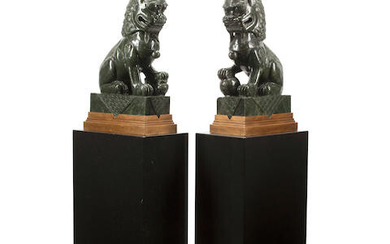 A PAIR OF CHINESE CARVED HARDSTONE FIGURES OF FU LIONS