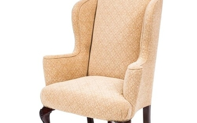 A carved mahogany wing frame armchair in the Georgian taste:...