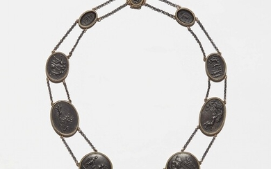 A gold and cast iron cameo necklace