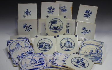 A group of approximately sixty Dutch Delft blue and white tiles, late 19th/early 20th century, inclu
