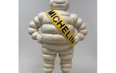 A painted metal Michelin man figure, standing on a wheel, 38...