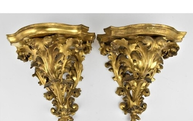 A pair of late 19th century gilt gesso wall brackets with sh...