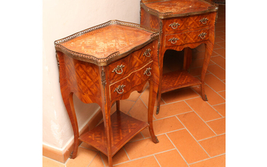 A pair of rosewood veenered night table