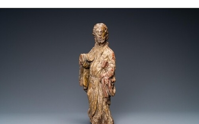 A polychromed wooden figure of an evangelist, 16th C.H.: 36,...