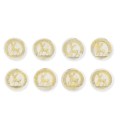 A set of eight Irish parcel-gilt silver buttons for the Northern Rangers