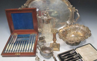 A silver plated two handled tray, a plated fruit bowl, a plate mounted caret jug, a set if plated