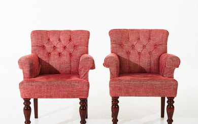 ARMCHAIRS, a pair, contemporary, front legs on wheel pulleys, armrests, seat and back upholstered in fabric.