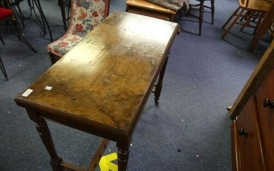 An Edwardian walnut and mahogany Games Table, the quarter ve...