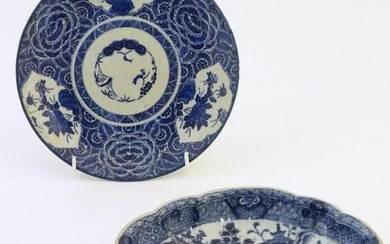 An Oriental blue and white plate with stylised peony