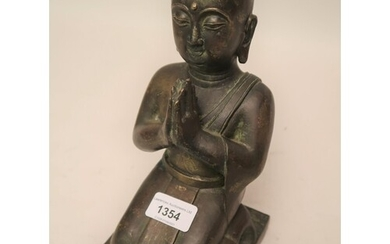 Antique patinated bronze figure of kneeling Buddha with trac...