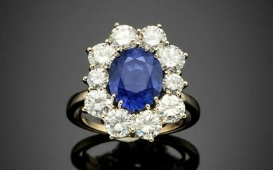 Oval ct. 3.70 sapphire and diamond white gold cluster