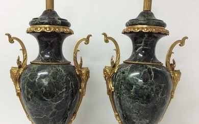 Pair of 18th century style gilt metal mounted verde antico marble table lamps, each of urn form with twin scrolling handles and leaf moulded bands on shaped square plinth and bun feet, height to ba...