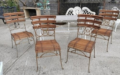 Set of four wrought iron and bamboo garden chairs {90 cm H x...