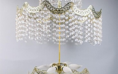 TWO HOLLYWOOD REGENCY STYLE METAL AND BEADED GLASS CHANDELIERS