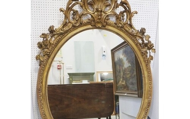 A 19th century gilt framed oval wall mirror with Rococo scro...