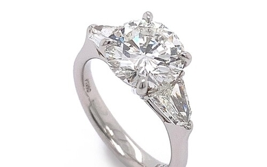A CLASSIC TRILOGY STYLE DIAMOND ENGAGEMENT RING A Classic Tr...