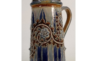A Doulton Lambeth jug decorated with scrolling foliage: by G...